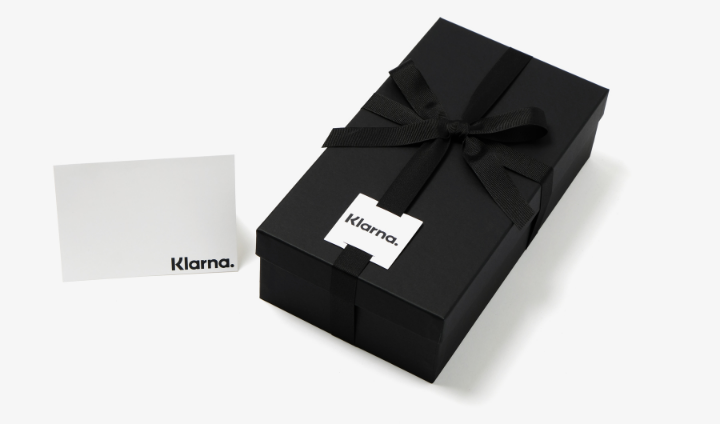 black gift box with black box and notecard