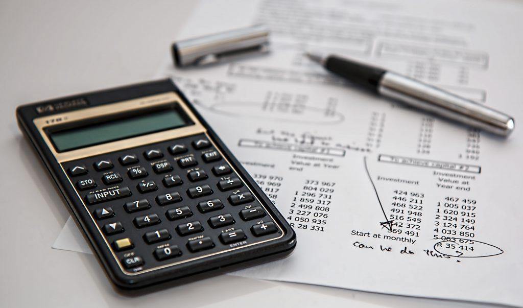 budgeting black calculator and expense sheet